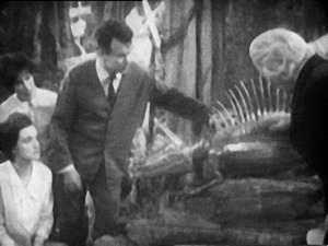 The Doctor and Ian look at the mechanical lizard